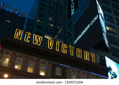 New York City, New York, United States - February 18, 2018: Exterior low angle view of the New Victory Theater at night, located off Broadway in Midtown Manhattan.