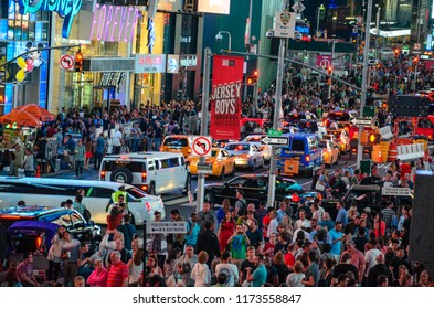 New York City, United States - June 2016: Night traffic at Time square. Urban street photography, New York at Night
