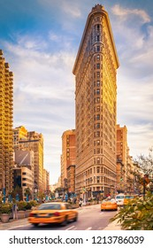 NEW YORK CITY, UNITED STATES - CIRCA OCTOBER 2016: The iconic Flatiron building with blured yellow cabs, New York City, USA