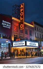 New York City, United States of America - September 30, 2015. Exterior view of the Apollo Theater in New York City, at night, with people lining up in front of the entrance.
