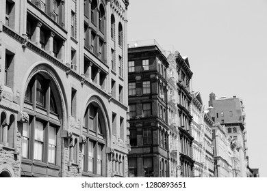 New York City, United States - old residential buildings in Soho. Black and white retro style.