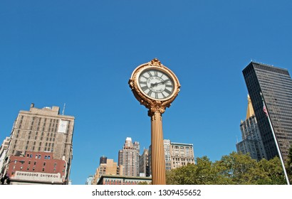 New York City, United States of America, Usa, September 16, 2014: the skyline of the city with view of an historic clock on the Fifth Avenue, at the intersection with Madison Square park