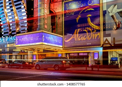 New York City, United States - October 25, 2016: Night view with busy traffic light trails of the New Amsterdam Theatre showing Disney's Aladdin musical on Broadway in Manhattan