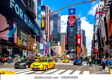 New York City, New York, United States of America 05/14/2017: Street at Times Square with yellow cabs, daylight