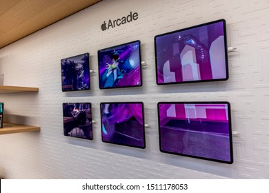 New York City, United States of America - September 20th 2019: Visiting the reopened Apple Store in 5th Avenue after the release of the new iPhone 11, viewing Apple Arcade display.