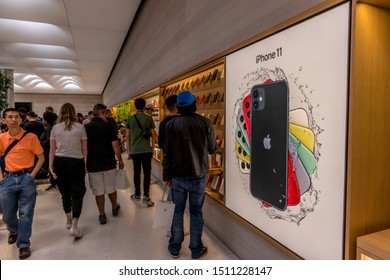 New York City, United States of America - September 20th 2019: Visiting the reopened Apple Store at 5th Avenue after the launch of the new iPhone 11, viewing displays of the new phone.
