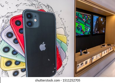 New York City, United States of America - September 20th 2019: Visiting the reopened Apple Store in 5th Avenue after the release of the new iPhone 11, viewing some advertisement displays.