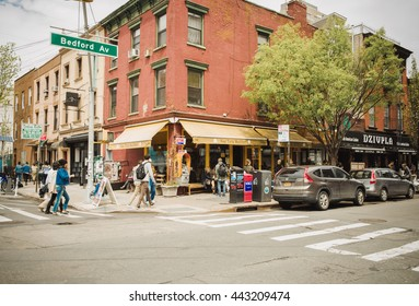 New York City, United States - April 23, 2016: Crowds of people walking along Bedford Avenue in Williamsburg, Brooklyn on a beautiful Weekend afternoon.