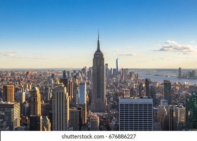 New York City, United States - May 15, 2017: Empire State Building and skyscrapers at sunset.