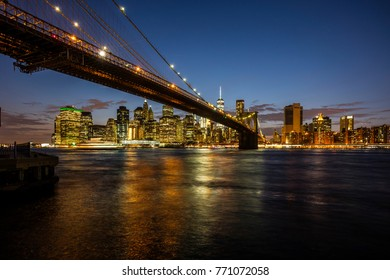 New York City, United States - August 26, 2017. From Brooklyn Bridge Park, Manhattan and the Brooklyn Bridge, at night.