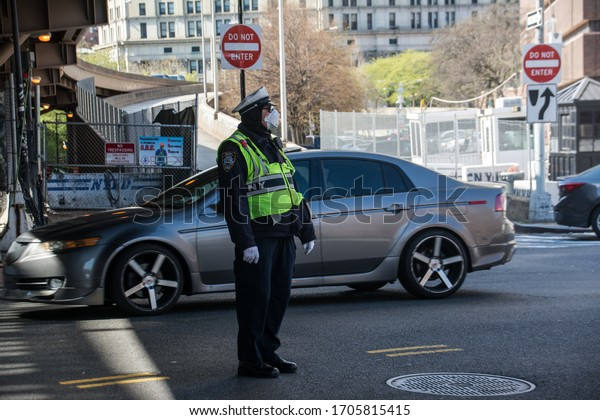 New York City, United States - April 15th, 2020: A police officer in NYC During Covi-19 Pandemic, wears a face mask