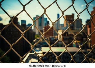 New York City urban view with historical architecture and graffiti behind fense