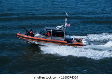 New York City, New York, USA - 02 25 2020: US Coast Guard during Ferry trip between Manhattan and Staten Island