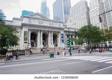 New York City, USA - 08/31/2017 : People by the main entrance of the New York Public Library, along 5th Avenue in Midtown Manhattan
