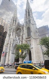 New York City, USA - 08/31/2017 : People by the main entrance of the cathedral of St. Patrick Roman catholic cathedral church in Manhattan.