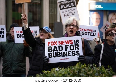 New York City, USA, 13th March 2019. Large Protest outside Fox News' Headquarters after Tucker Carlson's misogynistic, homophobic and racist comments.