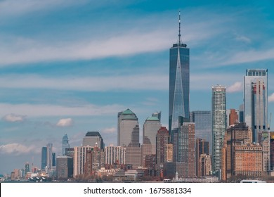 New York City, USA, 2019: view on skyline on sunny day. One WTC on Manhattan, skyscrapers and buildings