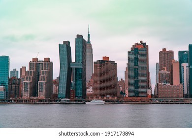 New York City, USA, 2019: City skyline on overcast day with Empire State building