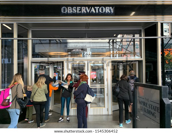 New York City / USA - 2019: People entering Empire State Building observatory