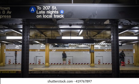 NEW YORK CITY, USA - 24 MARCH 2012: A candid view across the platforms of 14th St. subway station, NYC, with passengers waiting for both the express and local A trains.