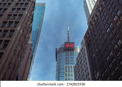 New York City, USA - 28 Dec 2019: H&M (Hennes & Mauritz) advertisement in a Skyscraper in Downtown Manhattan with other Buildings around