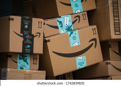 New York City, USA - 29 Dec 2019: Stack of brown Amazon Cardbord Parcels with Logo