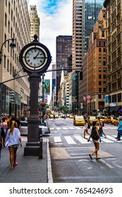 New York City, USA - 30 August 2014: Busy stret and sidewalk clock at 5th Avenue in Manhattan,  New York City, USA