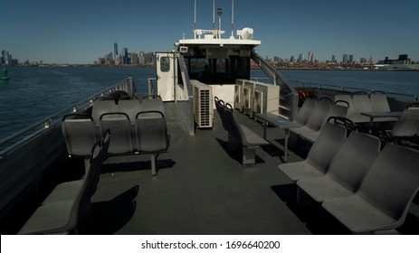 NEW YORK CITY, USA - : 3/28/2020 Empty seats on a Metropolitan Transit Authority a ferry as it heads to Manhattan from Brooklyn during the Coronavirus outbreak