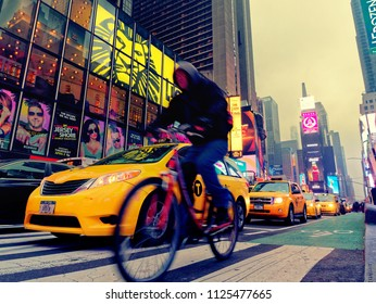 New York City, USA - Apr 2018: Taxis and bicycle in the traffic of times square in Manhattan