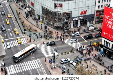 New York City, USA - April 7, 2018: Aerial view of urban building in NYC Herald Square Midtown with bus turning, red Macy's store, Verizon, HM