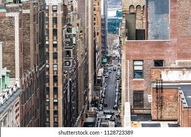 New York City, USA - April 7, 2018: Aerial view of urban road from rooftop building in NYC Herald Square Midtown with 35th street, Broadway, cars, traffic, skyscrapers