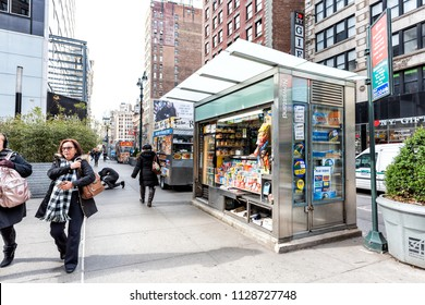 New York City, USA - April 7, 2018: Midtown Manhattan with people walking on street sidewalk on Broadway, Newsstand with newspaper, magazines, candy