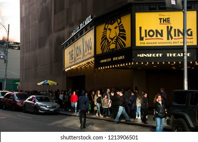 NEW YORK CITY, USA – APRIL 2018: Long queue at the Lion King Musical on Times Square in downtown Manhattan in New York City, USA