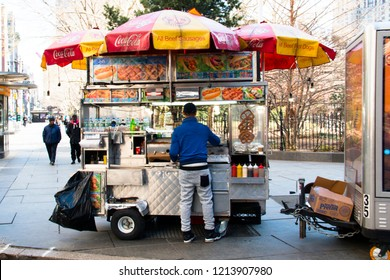 NEW YORK CITY, USA – APRIL 2018: A typical hotdog and bagel stand in central Manhattan in New York, USA