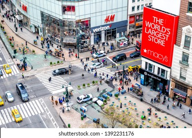 New York City, USA - April 7, 2018: Aerial high angle view of urban building in NYC Herald Square Midtown with red Macy's store, Verizon and HM