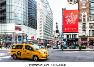 New York City, USA - April 7, 2018: Manhattan NYC buildings of midtown Herald Square 6th avenue west 34th street road signs for Macy's store, HM and taxi car in traffic