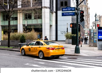 New York City, USA - April 7, 2018: Manhattan NYC buildings of midtown Herald Square Korean Town Korea Way road sign on west 32nd street with yellow taxi cab car
