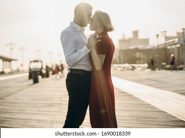 New York City, New York / USA - April 1 2020: Loving couple woman and man, romantic relationships, kissing and holding each other, walking on the beach together.