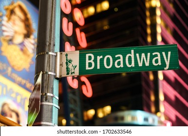 New York City, New York / USA - April 13 2020: Green Broadway street sight at Times Square in New York City.