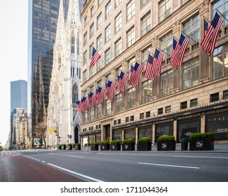 NEW YORK CITY, USA - APRIL 18, 2020:  Empty streets in midtown Manhattan, in New York City along Fifth Avenue with St. Patrick's Cathedral in view, during the global Covid-19 Coronavirus Crisis.