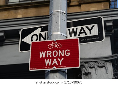 New York City, New York / USA - April 25 2020: Street sign. Wrong way street sign. One direction street sign in New York City.