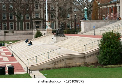 NEW YORK CITY, USA - APRIL 2, 2021: Sculpture Alma Mater and students on steps of Low Memorial Library on Morningside Heights campus of Columbia University in spring sunny day