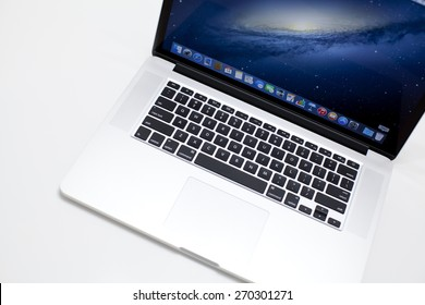 """New York City, U.S,A - April 14, 2015: Apple 15.4"""" MacBook Pro Notebook Computer with Retina Display on the white surface. It is a laptop computer that produced by Apple Inc."""