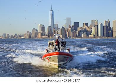 NEW YORK CITY, USA - APRIL 19: U.S. Coast Guard boat patrolling the Hudson River bay. April 19, 2015 in New York City, USA