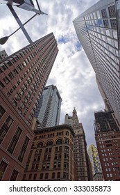 NEW YORK CITY, USA - APRIL 24, 2015: Low angle view of NYC skyscrapers with stormy sky. New York City skyscrapers are concentrated in Manhattan