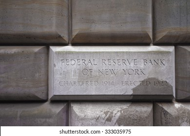 NEW YORK CITY, USA - APRIL 24, 2015: Sign table of the Federal Reserve Bank of New York, USA. The New York Fed implements monetary policy, supervises and regulates financial institutions