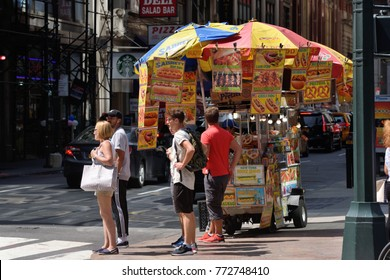 NEW YORK CITY, USA - AUG. 26: Street food cart in Manhattan on August 26, 2017 in New York City, NY. Manhattan is the most densely populated borough of New York City.