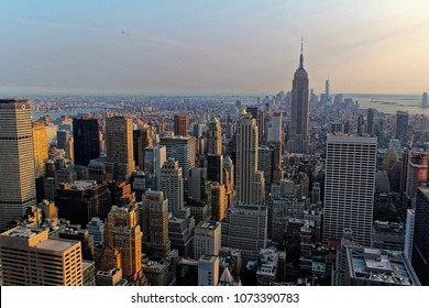New York City, USA - August 6, 2014: The Empire State Building, One World Trade Center, Times Square, and the skyline of downtown Manhattan at sunset from rooftop