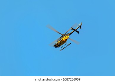 New York City, USA - August 11, 2012: Yellow with black Bell 407 helicopter in flight