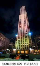 New York City, USA - August 11, 2012: Comcast Building with flags and golden statue at night in Rockefeller Center, Manhattan